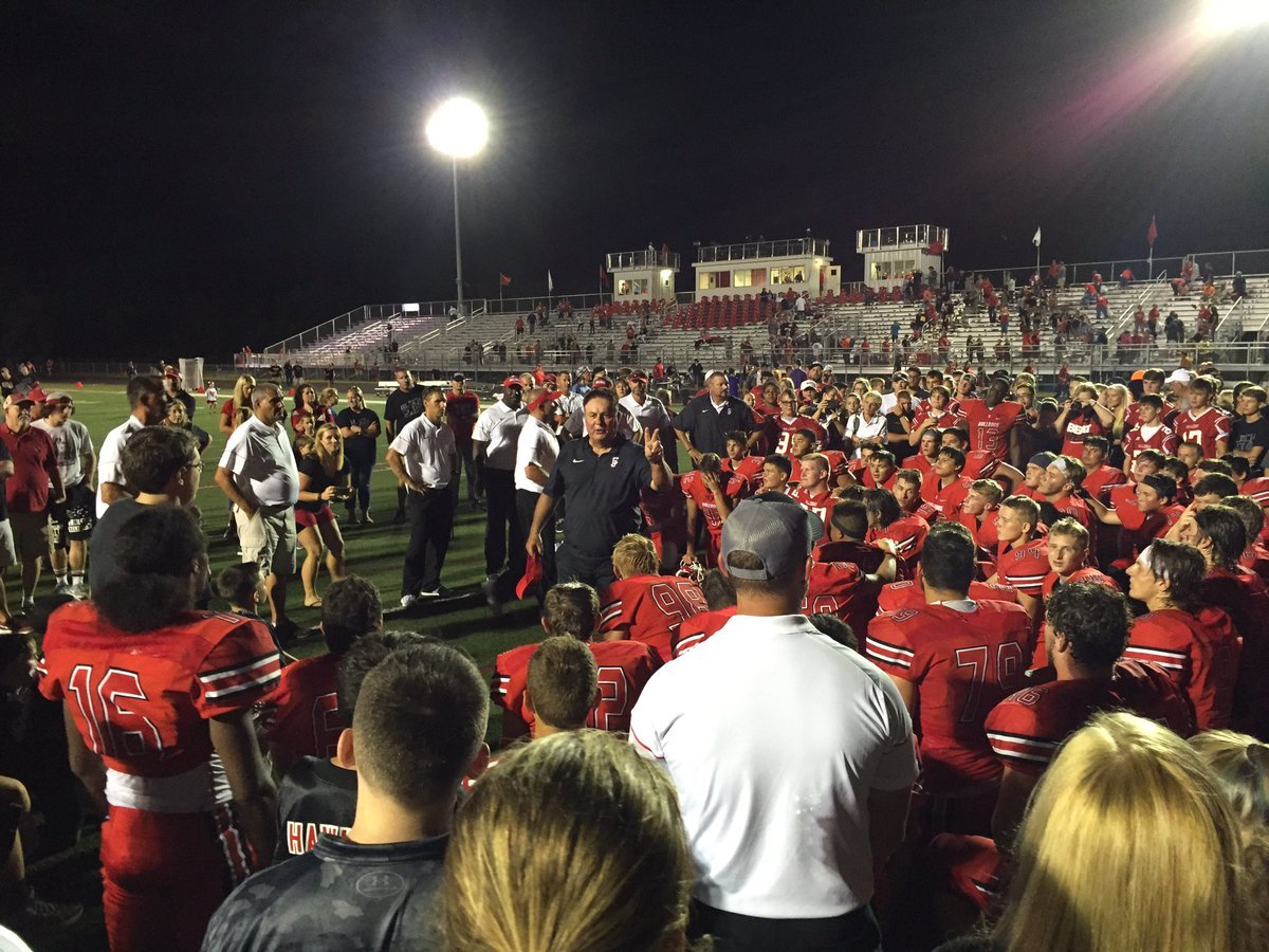 Carl Junction head coach Doug Buckmaster speaks to his team on the field after huge Central Ozark Conference-Large Division debut (photo by Andi Sioteco)