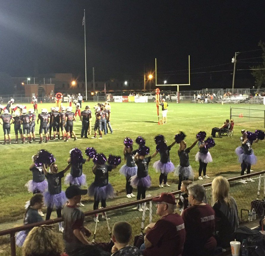 "Nevada High had a ""Tackle Cancer Night"" at the stadium as the Tigers defeated Springfield Central, 54-6. The Cheerleaders wore purple for cancer awareness. (Thanks to Anne Smoot -- @coachsmoot2 on Twitter -- for the photo)"
