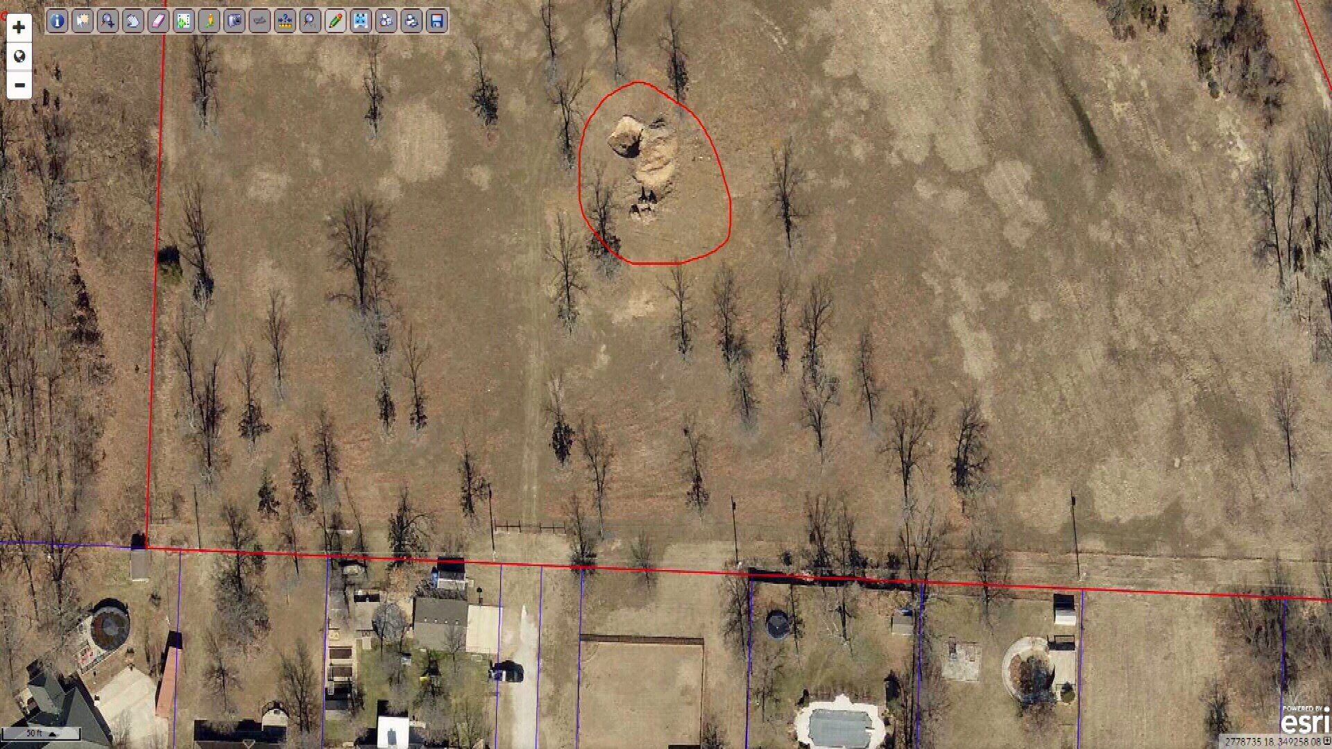 Satellite image showing hole on property