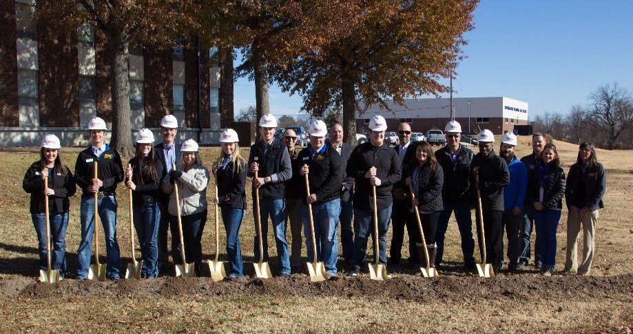 NEO administrators and student representatives break ground with projects partners.