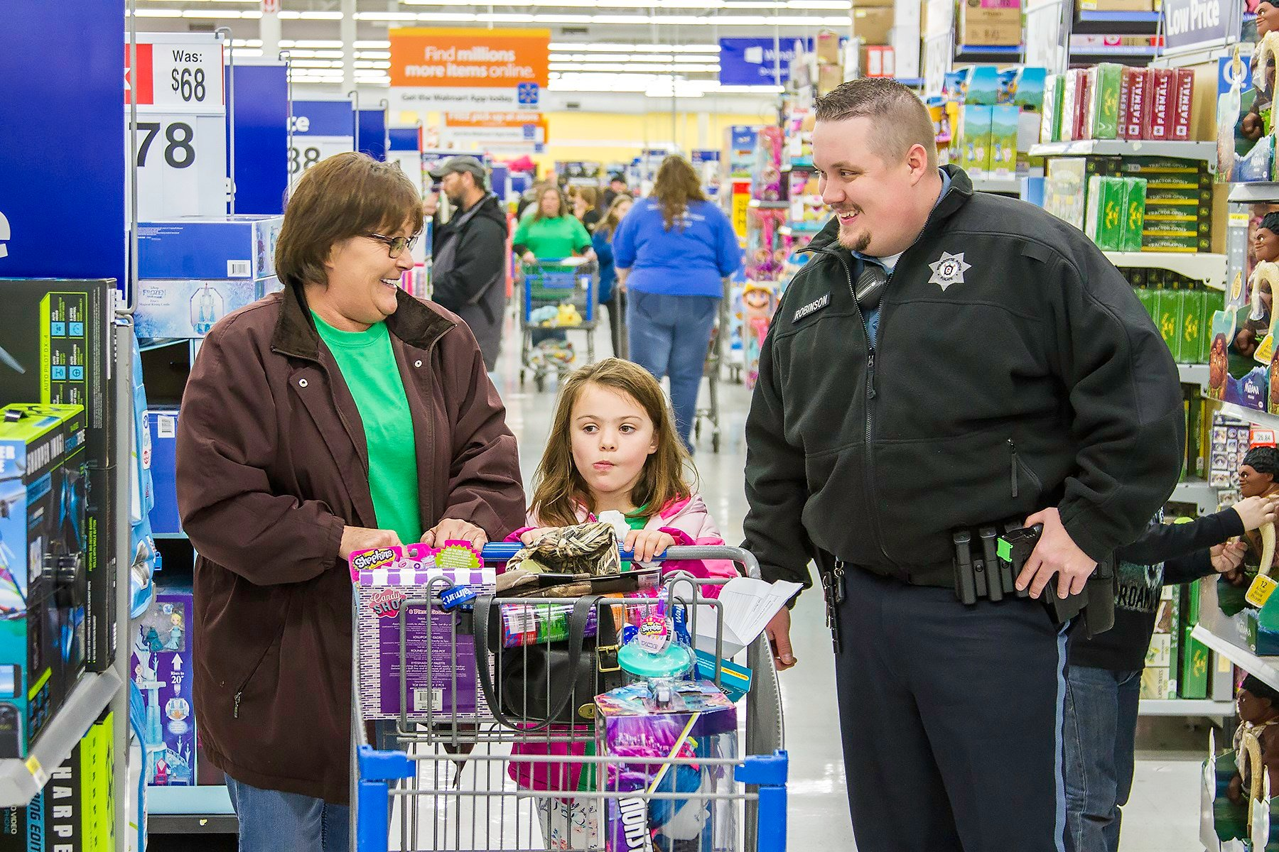 Susan Friend, Madison Homler, and Officer Jared Robinson enjoy a few laughs while shopping for gifts.