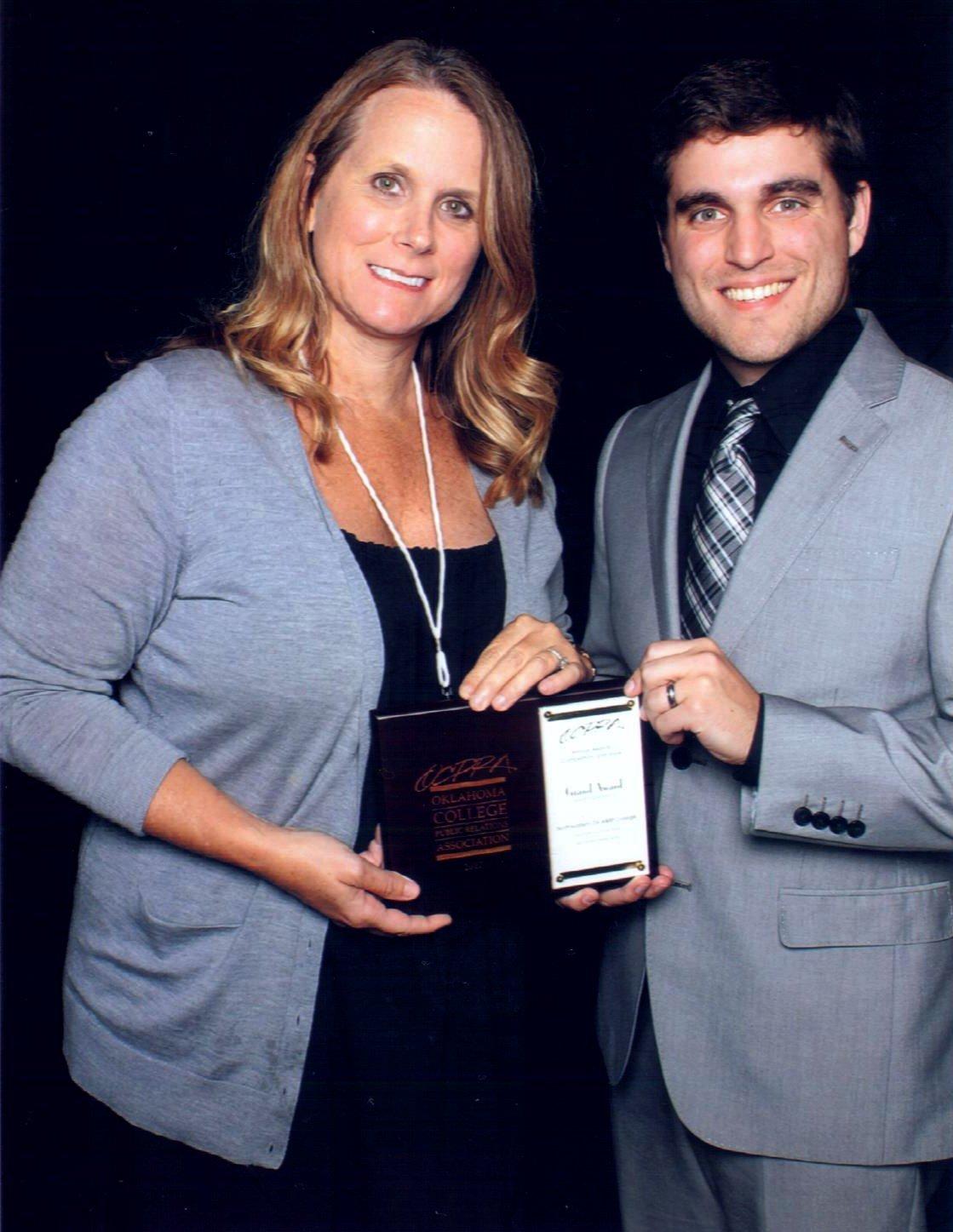 Jennifer Walker and Jordan Adams accepted awards on behalf of NEO.