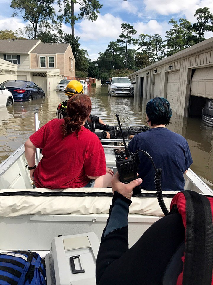 GRDA Police Officers transport two people away from their flooded residence in the Houston area. GRDA, along with firemen from Locust Grove, Adair and Pryor make up a Mayes County contingent that has been helping with rescue efforts following the devastat
