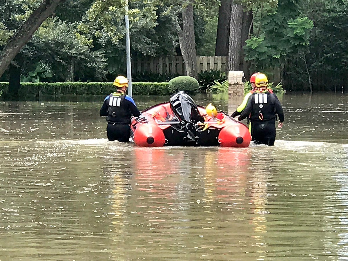 GRDA Police Officers guide their water rescue boat through a flooded neighborhood in the Houston area. These officers, along with other members of a Mayes County water rescue contingent, continue to lend a hand in Texas following the devastation left by H