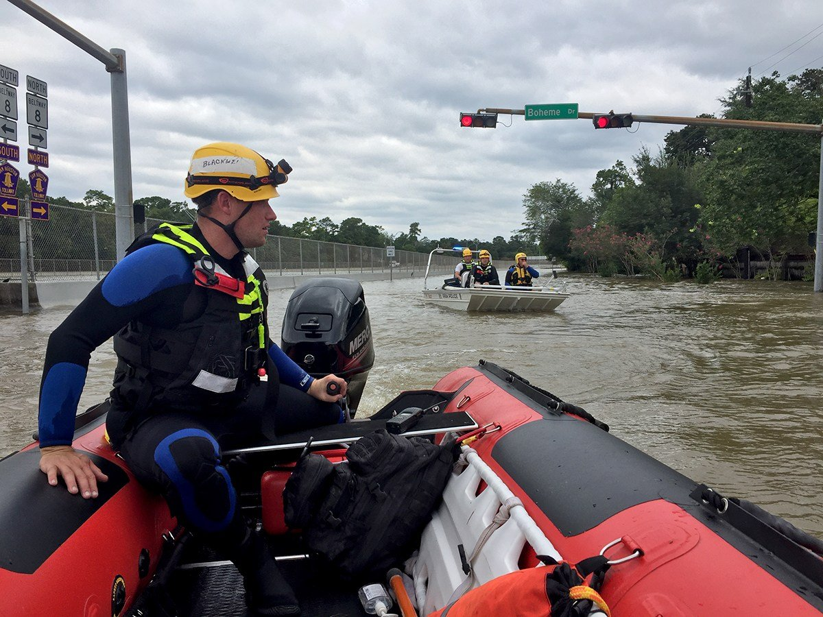 GRDA Police Officer Billy Blackwell navigates a water rescue boat down a flooded roadway in the Houston area. The boat in the background also contains GRDA officers. They have been in Texas since Monday evening, to help with water rescue efforts in the af