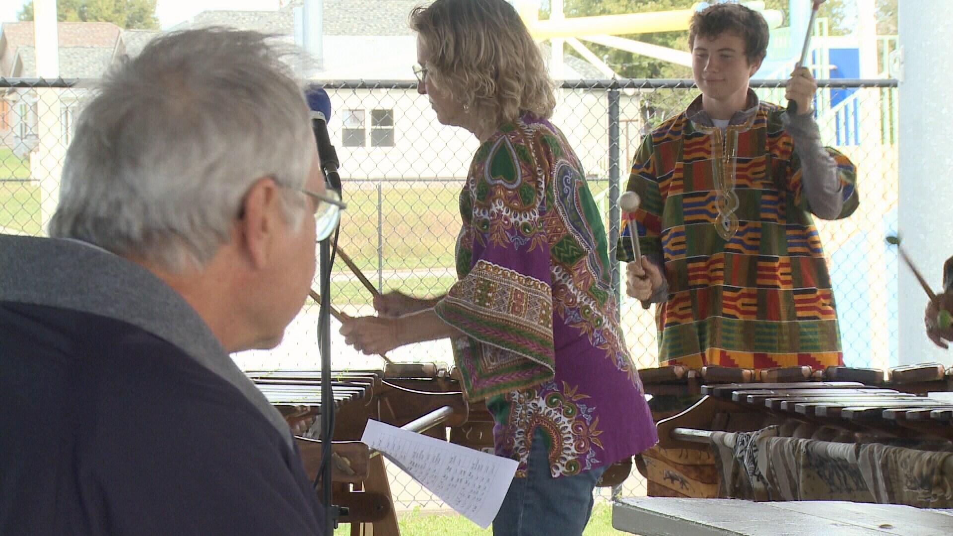 Attendees listen to Kufara, an African marimba band.