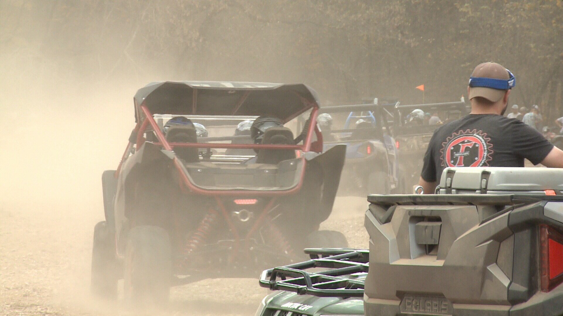 People test drive off-road vehicles on a Rush Springs Ranch trail.