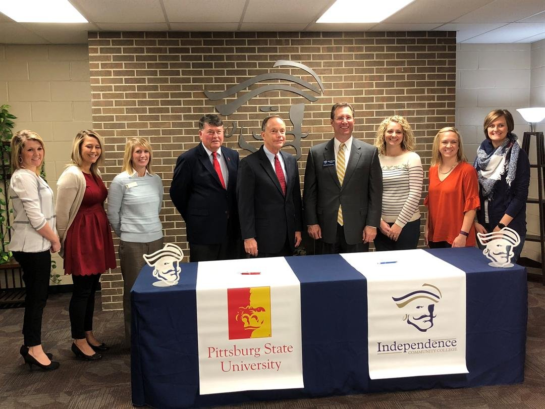 PSU President Steve Scott and ICC President Dan Barwick (center) were joined by representatives from each institution at a signing ceremony that officially marked the start of a partnership between the two institutions designed to help students.