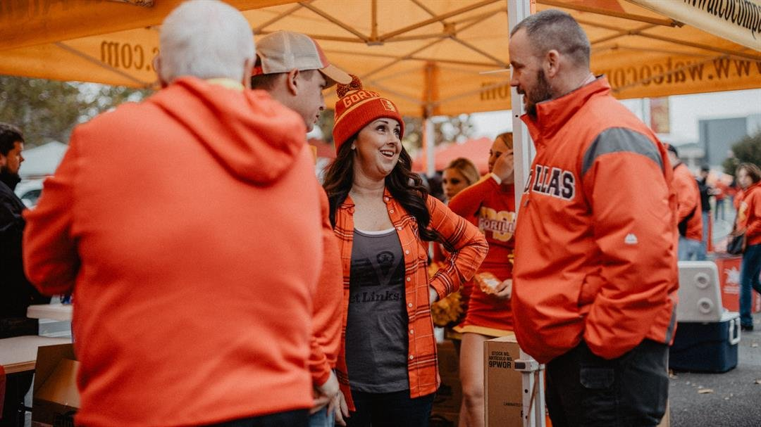 Pitt State graduate Becky Duncan (center) talks to Tim Senecaut, PSU's director of custodial and general services, during tailgating activities at Carnie Smith Stadium. Duncan is one of several PSU alumni who serve on the board of Vetlinks.org, a nonprofi