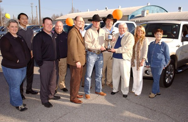 Representatives from Vance Ford, City of Miami, Miami CVB and Northeastern Oklahoma A&M College are shown with the trophy the group was awarded for being selected as Rodeo of the Year. Photo by Gary Crow for the Miami CVB.