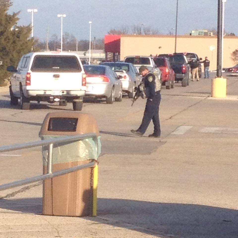 Law enforcement searching vehicles at the Walmart in Independence. (Photo by KOAM-Fox14 reporter Kelly Reid)