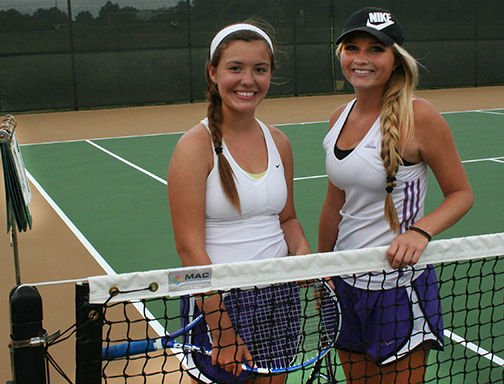 Evadne Rodriguez (left) and Thisbe Scholfield-Johnson defeated their opponents from Warrensburg High School Tuesday during the sectional match at TJ.