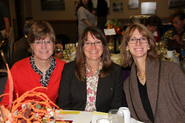 From left: Mary Booth, Jessica Stout and Ann Neal attended NEO's Foundation auction showing their support for education.