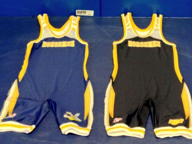 NEO's new singlets donated on behalf of the R.E.A.C.H.E.S. program, (Rewarding Educational Athletic Choices Helping Each Sport).