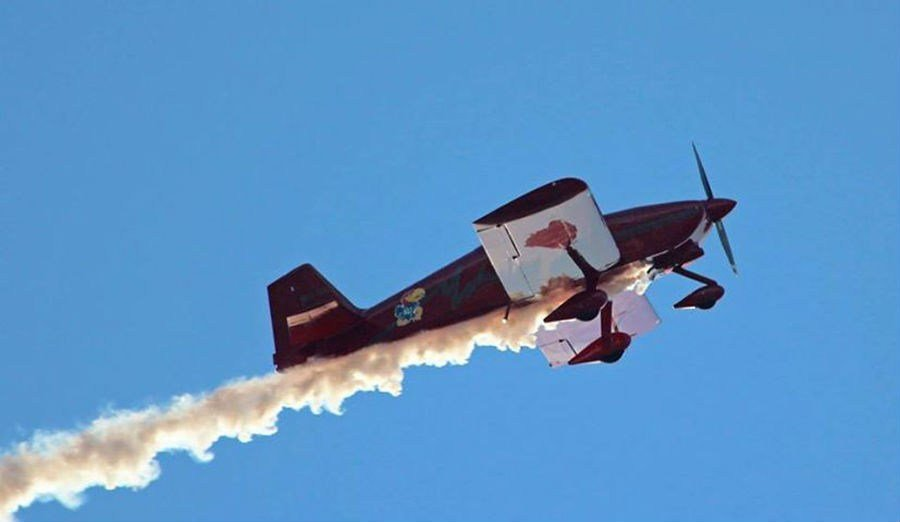 Dr. Alan Stuber trails smoke from his sport plane at a recent flyover.