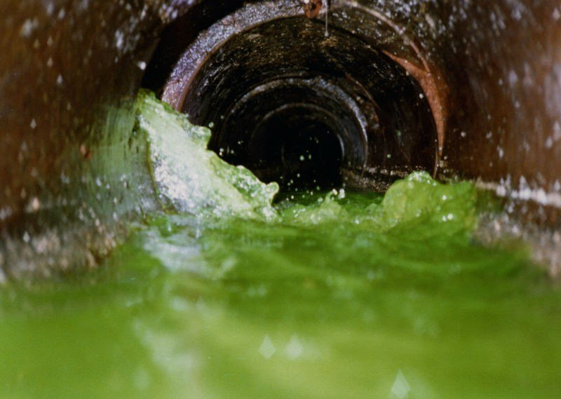 This is an example of another city's sewer system being dye-tested. Notice the flow and the bright color of the water used to track leaks in the system. Photo courtesy City of Parsons.