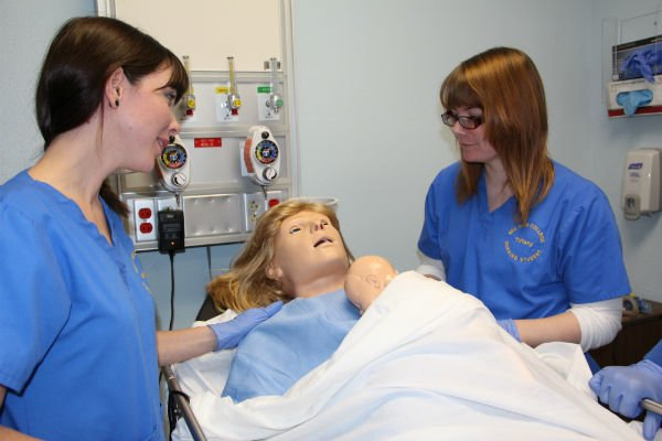 NEO nursing students Miranda Mayer (left) and Tiffany Shafer working with NOELLE® and Newborn Baby Hal® during class.