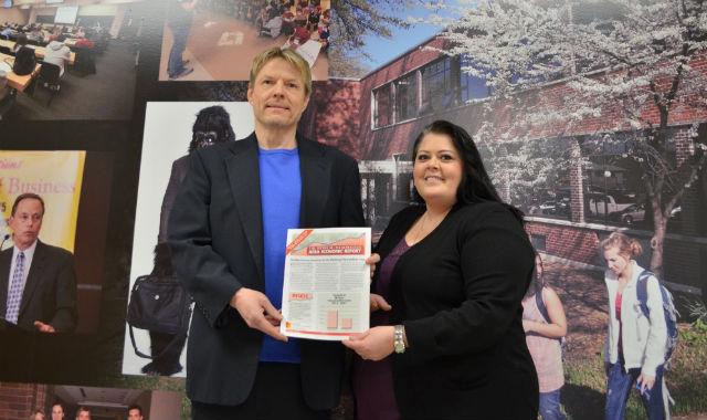 PSU Assistant Professor Michael Davidsson (left) and economic research assistant Deana Thompson develop the quarterly Pittsburg Micropolitan Area Economic Report.