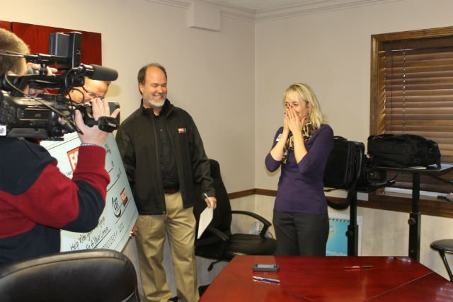 Heather Boline of Carl Junction is surprised by Fox 14 GM Darren Dishman.