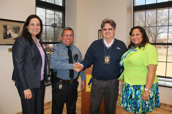 (from left) Cara Cowan Watts, councilwoman for the Cherokee Nation, Lt. David Noel, recipient of the Cherokee Warrior Award and Medal of Patriotism, Police Chief Tom Robertson, and Claudia Little Axe, director of the American Indian Center for Excellence