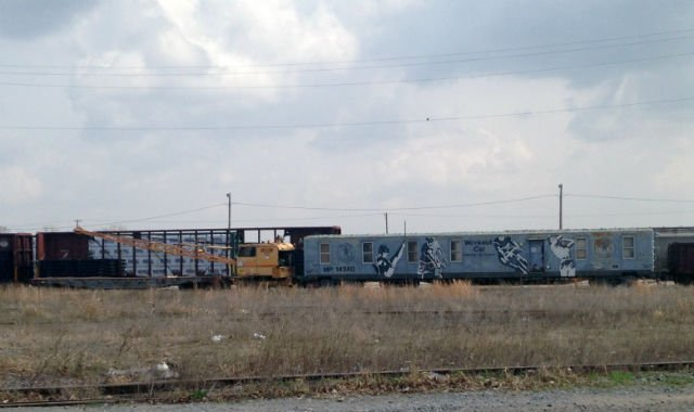 The crane, flat car and workout car, which was formerly a baggage car sit on the Union Pacific Railroad tracks near 22nd St. and Dirr on Friday. The cars were moved to their final destination by rail and crane on Sunday.