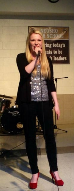 "Jaclyn Kidd, senior, 2nd runner-up for People's Choice, dedicated the song ""Long Live"" to all the friends and memories she has made at Neosho High School."