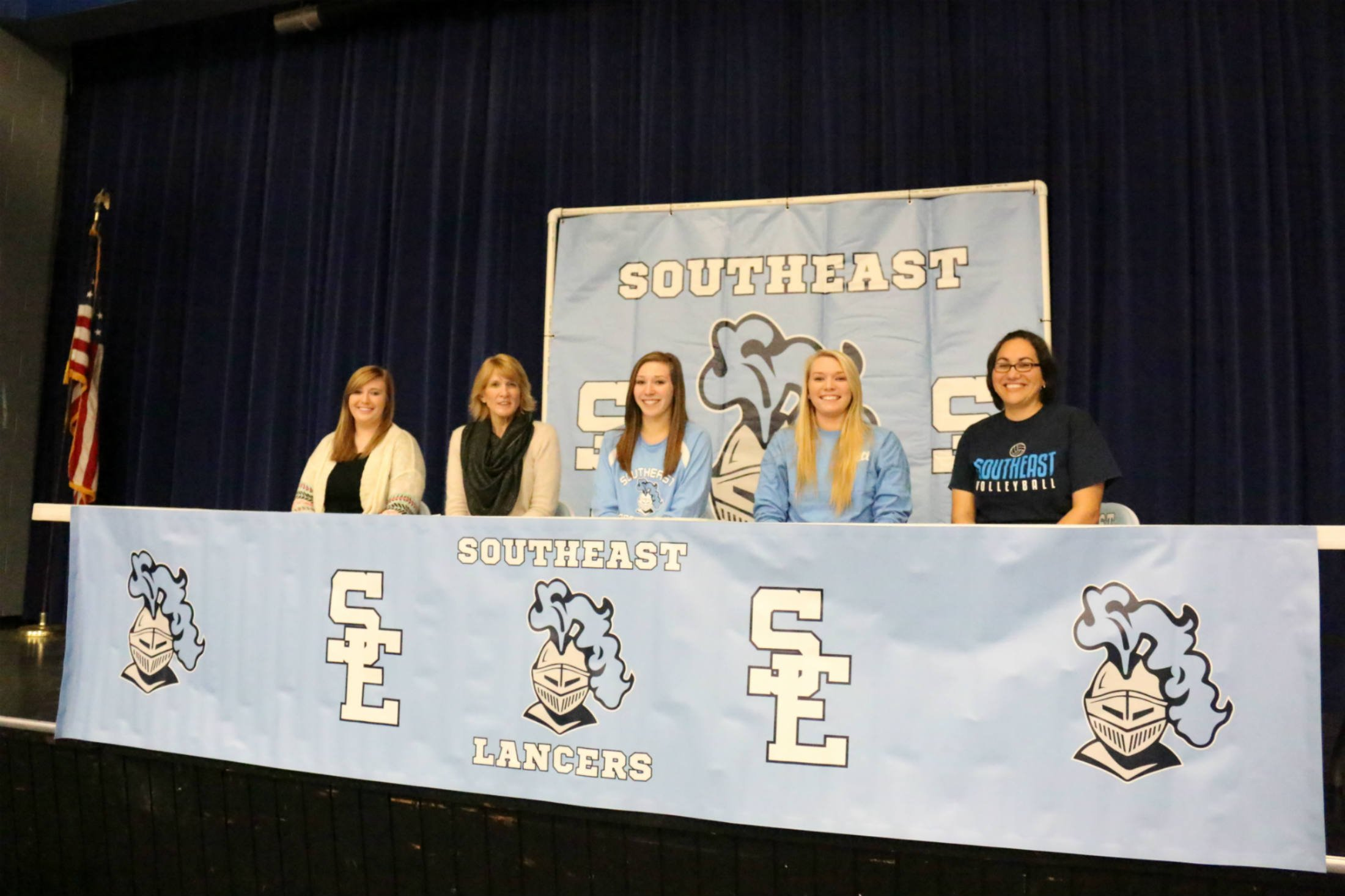 Southeast senior Madison Bone has signed to play volleyball at Labette Community College.  The future veterinarian was recognized at a recent Southeast High School assembly with her family and coach.  Left to right are Jessica Renn, Janice Bone, Madison B