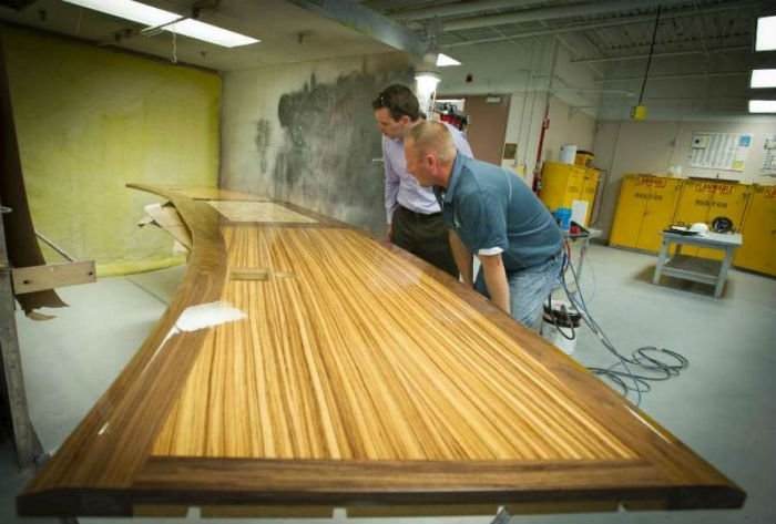 Wood technology faculty Doug Hague, left, and Charlie Phillips look over a table top that they built for a new conference room at the Kansas State Department of Education offices in Topeka.