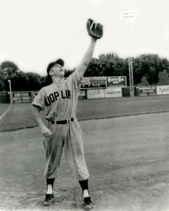 Mickey Mantle holds his glove in the air during his time with the Joplin Miners. Photo courtesy: Joplin Museum Complex
