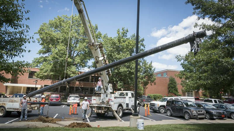 Workers install a small cell tower on the PSU campus, Tuesday. The additional towers are expected to improve cellular service across campus.