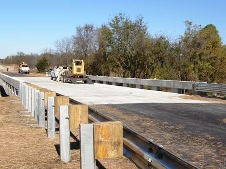Workers apply finishing touches to the bridge rail on the K-3 bridge over Hinton Creek in Bourbon County. KDOT opened the new bridge to traffic Tuesday, Nov. 3.