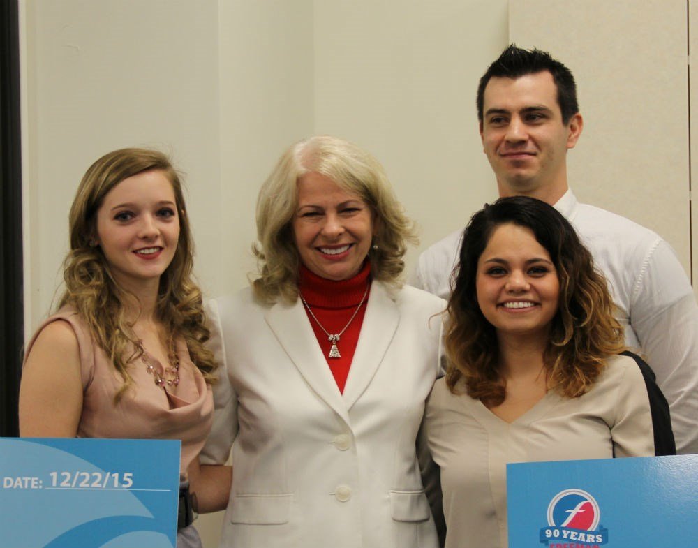 (left to right) Elisabeth Anderson, scholarship recipient; Paula F. Baker, Freeman President and Chief Executive Officer; Amelia Kramer, scholarship recipient and Dmitry S. Romanov, scholarship recipient