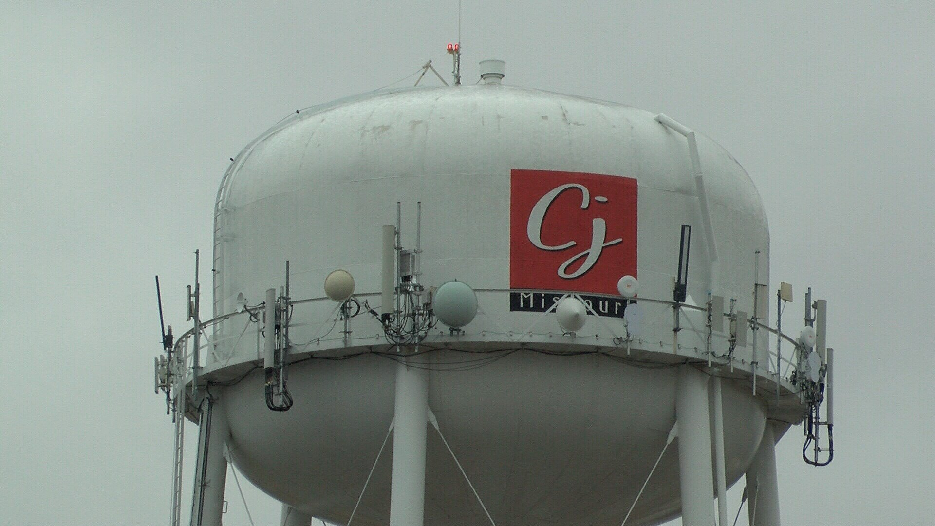 Output antennas on one of three water towers in Carl Junction