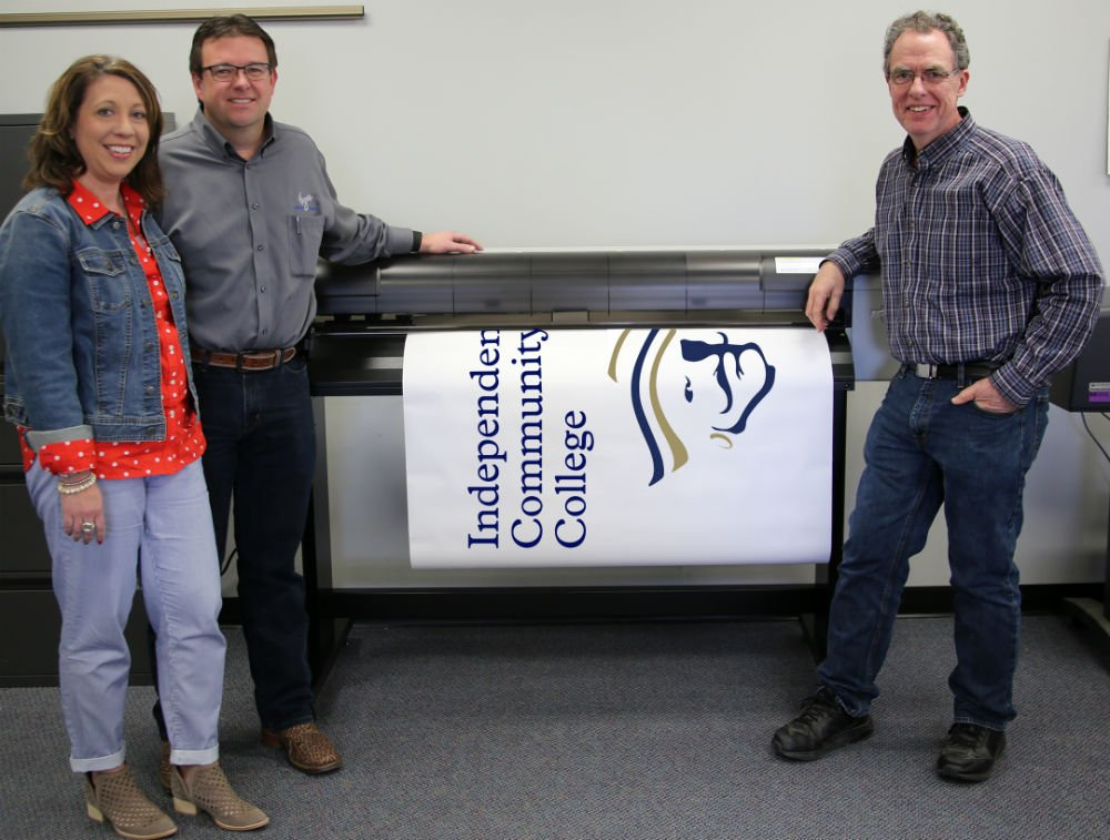 Caption: Lisa and Cory Hugo (left) with Fab Lab director, Jim Correll and the new Mutoh printer.