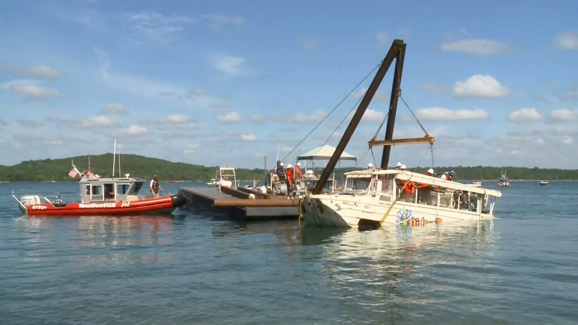 The duck boat that sank in Table Rock Lake in Branson, Mo., is raised Monday, July 23, 2018. The boat went down Thursday evening.